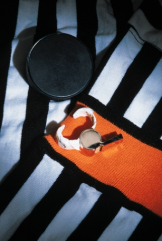 Hockey ref jersey, whistle and puck