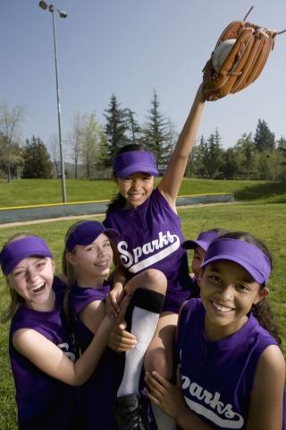 Young girls playing baseball