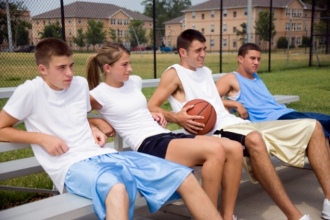 Basketball Players Relax on the Bench