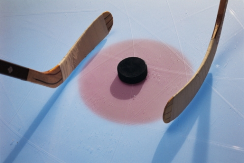 Hockey sticks and a puck