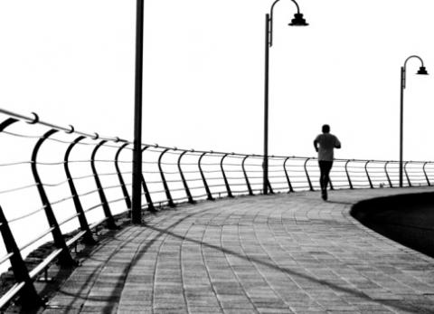 A lone runner on the boardwalk