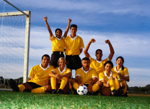 A group of soccer players pose for a team photo