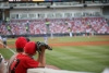 Young baseball fans sit ready to catch a fly ball
