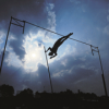 A pole vaulter goes over the top