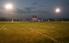 A football field is lit at twighlight