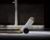 Close up view of hockey stick and puck